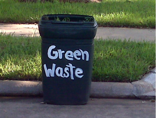 "Trash can with ""green waste"" painted on it"